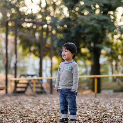 child-standing-on-autumn-leaves-picture-id1080887768.jpg